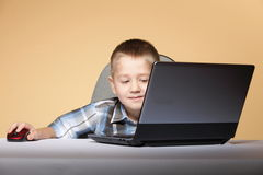 Computer addiction child with laptop notebook Royalty Free Stock Photography