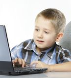 Computer addiction child with laptop notebook Royalty Free Stock Image