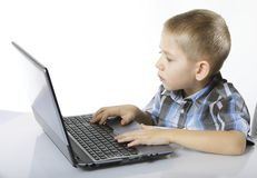 Computer addiction child with laptop notebook Stock Image