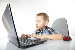Computer addiction child with laptop notebook Stock Images