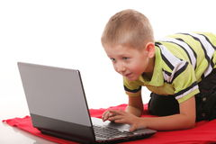 Computer addiction emotional boy with laptop. Computer addiction emotional child boy with laptop notebook playing games isolated on white background Royalty Free Stock Photography