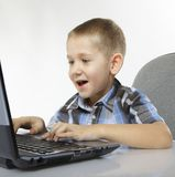 Computer addiction emotional boy with laptop Stock Images