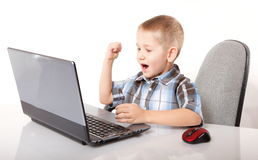 Computer addiction emotional boy with laptop Royalty Free Stock Photos