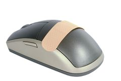 Computer Aid. A cordless mouse with a adhesive bandage on it.  Isolated on white withclipping path Royalty Free Stock Images