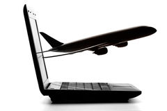 Computer with aircraft Royalty Free Stock Photos