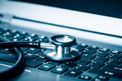 Computer analysis using a stethoscope Royalty Free Stock Photo