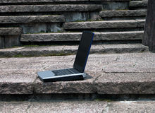 Computer anywhere. Laptop on the rocks stairs Royalty Free Stock Photos