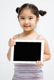 Computer asiatico felice della compressa della tenuta del bambino Fotografia Stock