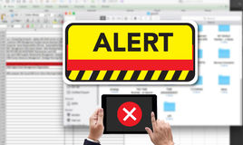 Computer Attention Alert Connection Interrupted Warning and Atte. Ntion, on the tablet pc screen held by businessman hands - online, top view Royalty Free Stock Photo