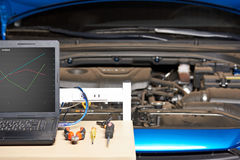 Computer auto diagnostic. Closeup of working place table. Tools for electronic maintenance vehicle stock photos