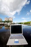 Computer on the bay. I photo of a laptop set on top of a dock in the bay Stock Image