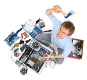 Computer being destroyed by annoyed madman Royalty Free Stock Photography