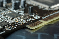 Computer board. Close up of computer board with microchip, resistors and condensators Stock Photo