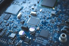 Computer board chip circuit cpu core blue technology background. Or texture with processors microelectronics hardware concept electronic device motherboard stock photos