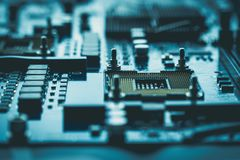 Computer board chip circuit cpu core blue technology background. Or texture with processors microelectronics hardware concept electronic device motherboard royalty free stock images