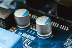 Computer board chip circuit cpu core blue technology. Background or texture with processors microelectronics hardware concept electronic device motherboard royalty free stock photos