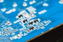 Computer board chip circuit cpu core blue technology. Background or texture with processors microelectronics hardware concept electronic device motherboard royalty free stock photography
