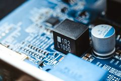 Computer board chip circuit cpu core blue technology. Background or texture with processors microelectronics hardware concept electronic device motherboard stock image