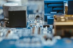 Computer board chip circuit cpu core blue technology. Background or texture with processors microelectronics hardware concept electronic device motherboard stock photo