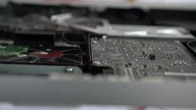 Computer board close-up. Repair of the disassembled computer stock video footage