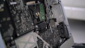 Computer board close-up. Repair of the disassembled computer stock footage