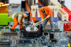 Computer board and construction workers Stock Images