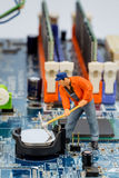 Computer board and construction workers Royalty Free Stock Photo