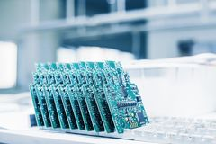 Computer boards. Computer techologies. Spare parts. Computer parts manufacturing plant. Stock Photos