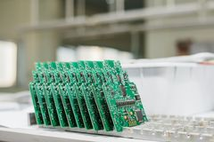Computer boards stand in a row at the factory for the production of spare parts. Modern technologies royalty free stock photo