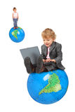 Computer boy on big globe and girl on globe Stock Photo