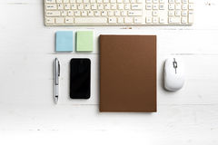 Computer and brown notebook with office supplies Royalty Free Stock Photography