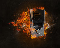 Computer burning with fire Royalty Free Stock Images