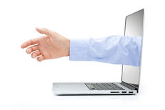 Computer Business Contact Marketing. A hand coming out of a computer screen to shake hands with someone else isolated on white Stock Photography