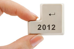 Computer button 2012 in hand. Isolated on white background Stock Photos