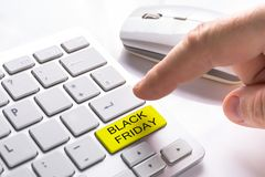Computer button with Black Friday sign. Finger pressing computer button with Black Friday sign Royalty Free Stock Photos