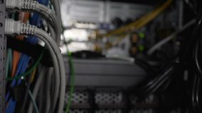 Computer cables and communications, server room with networking hardware closeup. Stock footage stock video