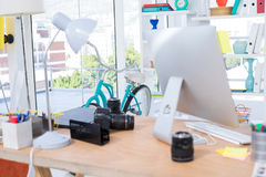 Computer, camera and office accessories on table Stock Photo