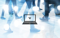 Computer and cart graphic on people walk shopping background, abstract blur and blue tone concept Stock Image