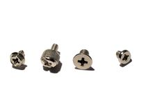 Computer case screws. Four types of screws most likely used in a computer tower Stock Photos