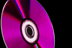 Computer cd dvd blue-ray disk. Close-up computer cd dvd blue-ray disk isolated on black Royalty Free Stock Images
