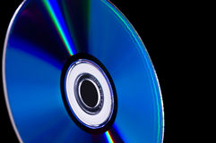 Computer cd dvd blue-ray disk. Close-up computer cd dvd blue-ray disk isolated on black Royalty Free Stock Photos