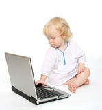 Computer and child Stock Images