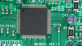 Computer chip on circuit board Royalty Free Stock Images
