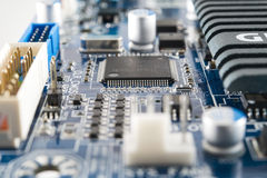 Computer chip integrated on circuit board. Computer chip integrated on blue circuit board Royalty Free Stock Images