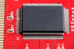 Computer chip on the red board. Close up Royalty Free Stock Photos