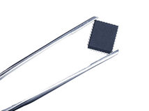 Computer chip with tweezers, isolated stock images