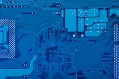 Computer circuit board. Close up of computer circuit board in blue Royalty Free Stock Photo