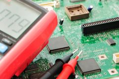 Computer circuit board. And testing equipment Royalty Free Stock Images