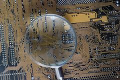 Computer circuit board. Closeup of a computer circuit board with magnifying board Stock Photography