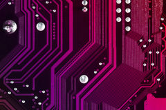 Computer circuit board background. Computer circuit board in pink color Royalty Free Stock Photo